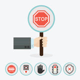 Male hand holding vertical circle paddle stick with stop sign Stock Image