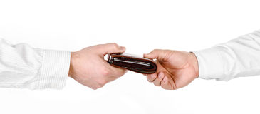Male hand holding a wallet and handing it over to another person Royalty Free Stock Image