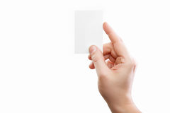 Male hand holding white business card at isolated background Royalty Free Stock Photo