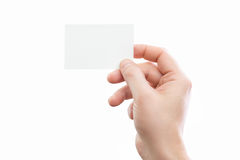 Male hand holding white business card at isolated background Royalty Free Stock Image