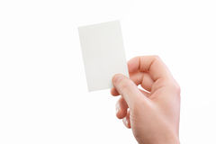 Male hand holding white business card at isolated background Royalty Free Stock Photos