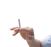 A male hand holding a white cigarette, isolated on white Stock Photo