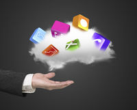 Male hand holding white cloud with colorful app blocks Royalty Free Stock Photography