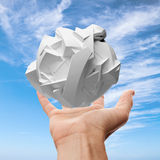 Male hand holding white flying fragmented 3d object Royalty Free Stock Images