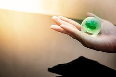 Male hand holding world globe crystal glass. Global business or climate change concepts. World environment day. Male hand holding green world globe crystal glass royalty free stock photos