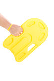 Male hand holding a yellow swimming float Stock Photography