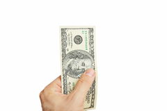 Male hand holdingthousand dollar. Isolated on white background Stock Photo