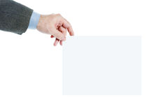Male hand holds blank sheet of white paper Royalty Free Stock Photography