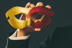 Male hand holds carnival mask closeup Royalty Free Stock Photos