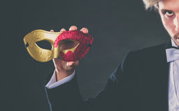 Male hand holds carnival mask closeup Stock Photography