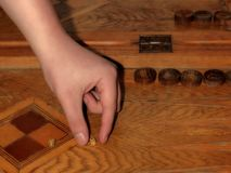 Male hand holds dice in the game of backgammon royalty free stock photos