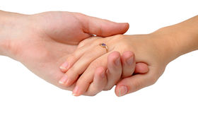 Male hand holds female hand Stock Image