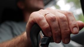 Male hand holds gear box. The driver switches the manual transmission in the car. Man rides by automobile. Closeup. 4k. Male hand holds gear box. The driver stock footage