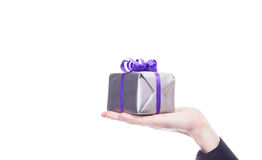 Male hand holds silver gift Royalty Free Stock Image
