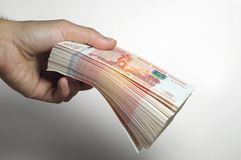 Male hand holds a thick stack of cash money. Million Russian rubles. The concept of rich, wealth, profits, business and finance. F. Million Russian rubles. The royalty free stock photo