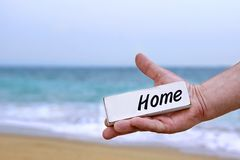 Male Hand with HOME signboard Stock Photography