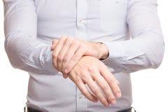 Male hand hurts wrist arm Stock Image