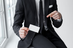 Male hand indicating an empty business card Royalty Free Stock Photos