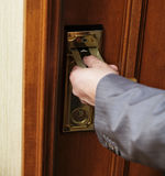 Male Hand Inserting Key Card Into Hotel Room Door Lock Royalty Free Stock Image