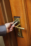 Male Hand Inserting Key Card Into Hotel Room Door Lock Stock Photography