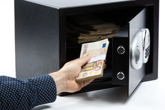 Male hand keeping euro banknotes in a safe deposit box Stock Images