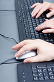 Male hand on keyboard typing and scroll mouse Stock Images