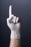 Male hand in latex glove pointing up Royalty Free Stock Images