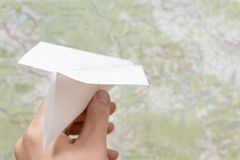 Man hand with paper plane stock photo