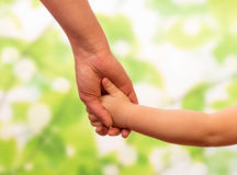 Male hand leading child Royalty Free Stock Images