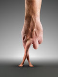 Male hand with legs Stock Photography