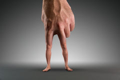 Male hand with legs Stock Image