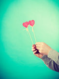 Male hand with little hearts on sticks. Royalty Free Stock Images