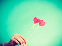 Male hand with little hearts on sticks. Stock Photos
