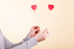 Male hand with little hearts on sticks. Royalty Free Stock Photography