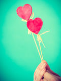 Male hand with little hearts on sticks. Royalty Free Stock Image