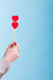 Male hand with little hearts on sticks. Stock Image