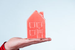 Male hand with little red house. Stock Image