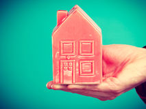 Male hand with little red house. Stock Photo