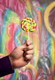 Male hand with a lollipop Royalty Free Stock Photography