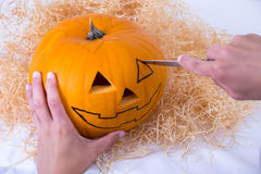 Male hand making pumpkin Jack O'Lantern for Halloween Royalty Free Stock Photography