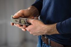 Male hand with money. stock image