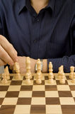 Male hand moving chess Royalty Free Stock Photos