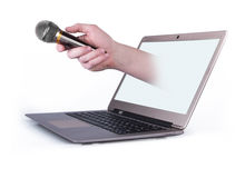 Male hand with notebook and with microphone Royalty Free Stock Photo
