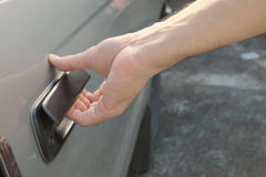 Male hand opening car door Royalty Free Stock Images