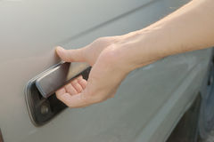 Male hand opening car door Stock Images