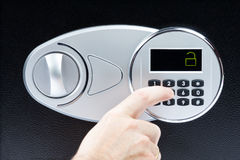 Male hand opening electronic door of a safe deposit box Royalty Free Stock Photo