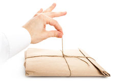 Male hand opening envelope tied with a rope Royalty Free Stock Photo