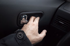 Male hand opens the car door with inner handle Royalty Free Stock Photos