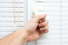 Male hand opens a window stock image