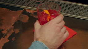 Male hand paying for a cocktail. Close up. Professional shot in 4K resolution. 070. You can use it e.g. in your commercial video, business, restaurant, pub stock video